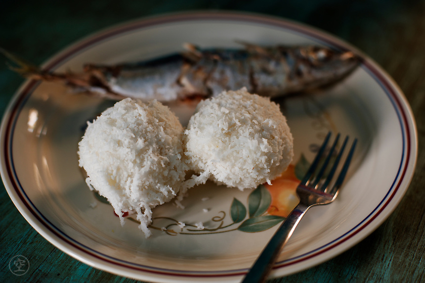 Typical traditional dish in the Marshall Islands: coconut rice and grilled fish.