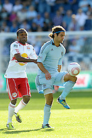 Sporting KC midfielder Graham Zusi (8) marked by Dane Richards (19) Red Bulls...Sporting Kansas City defeated New York Red Bulls 2-0 at LIVESTRONG Sporting Park, Kansas City, Kansas.