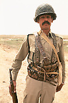 Marsh Arabs. Southern Iraq. Circa 1985. Marsh Arab  soldier with gun belts.