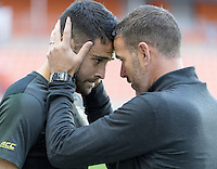 Houston, TX - Friday December 9, 2016: Wake Forest Demon Deacons Head Coach, Bobby Muuss (right) with his goalkeeper, Andreu Cases Mundet prior to there game with the Denver Pioneers at the NCAA Men's Soccer Semifinals at BBVA Compass Stadium in Houston Texas.