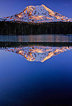 Mount Adams reflected in icy Takhlakh Lake at sunset, South Cascades Mountain Range, Washington State