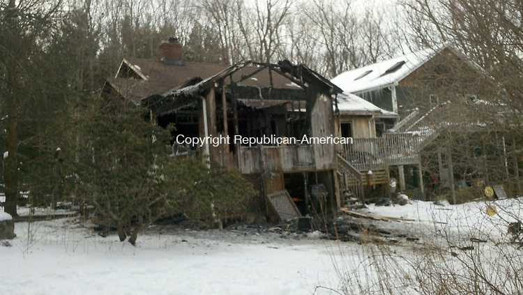 COLEBROOK, CT - 28 Jan. 2014 - 012814KM01 - The rear of the house at 16 Chapin Road in Colebrook was destroyed by fire early Tuesday morning. Kurt Moffett Republican-American