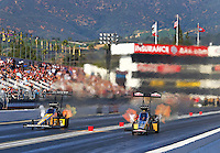 Feb 12, 2017; Pomona, CA, USA; NHRA top fuel driver Tony Schumacher (left) races alongside Leah Pritchett during the Winternationals at Auto Club Raceway at Pomona. Mandatory Credit: Mark J. Rebilas-USA TODAY Sports
