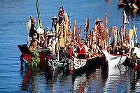 Native American Indians canoeing in Traditional Dugout Canoe at Indigenous Games, Victoria, BC, British Columbia, Canada