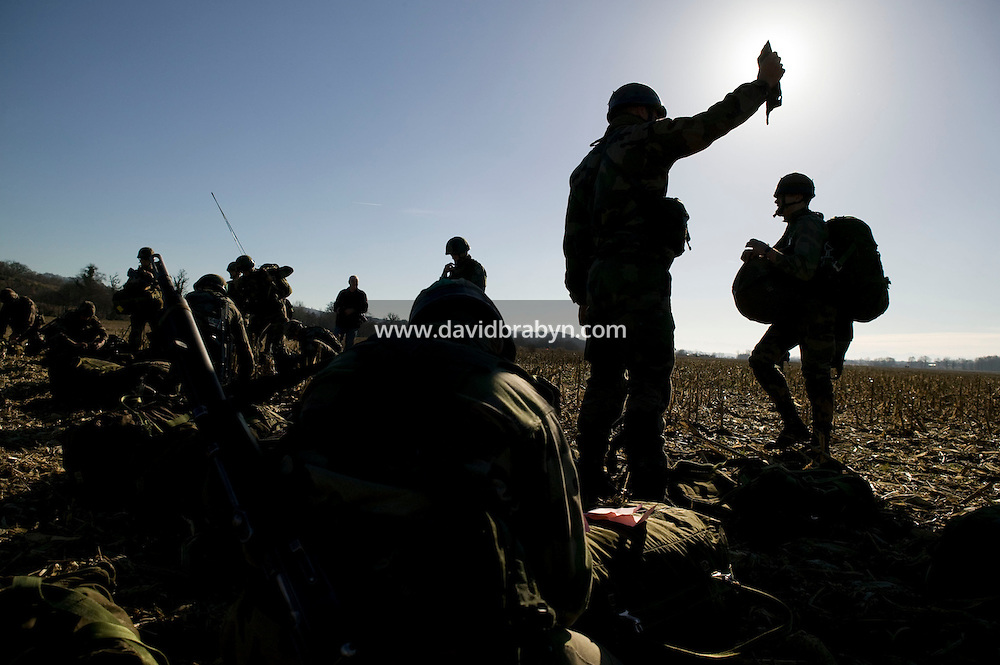 Members of the French Foreign Legion gather at their assigned position after jumping over a plain north of Tarbes, France, during a full scale multi-force exercise, 12 December 2007.