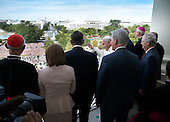 Standing with members of Congress, His Holiness Pope Francis waves to the crowd from the Speakers Balcony at the US Capitol, Thursday, Sept. 24, 2015.<br /> Credit: Doug Mills / Pool via CNP