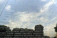 Jun 14, 2004; Washington DC, Washington, USA;  Vietnam Veterans War Memorial names of fallen soldiers with the off-white Washington Monument reflected in the lower right hand corner inside the Constituion Gardens.