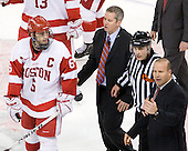 Joe Pereira (BU - 6), Mike Bavis (BU - Associate Head Coach), Bob Bernard, Greg Cronin (Northeastern - Head Coach) - The visiting Northeastern University Huskies defeated the Boston University Terriers 5-4 on Sunday, March 13, 2011, to win their Hockey East Quarterfinal matchup 2 games to 1 at Agganis Arena in Boston, Massachusetts.