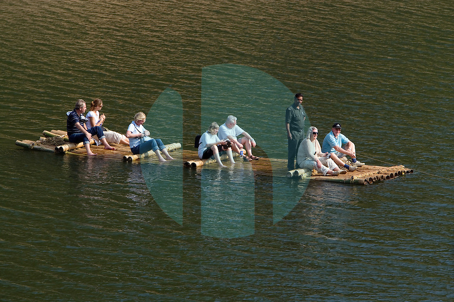 20080131_Periyar, India_ Tourists in a small bamboo raft cross a section of the Periyar Lake, which is located in the Periyar Wildlife Sancuary in the Southern Indian state of Kerala.  Photographer: Daniel J. Groshong/Tayo Photo Group