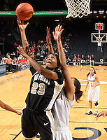 Feb. 3, 2011; Charlottesville, VA, USA; Wake Forest Demon Deacons guard Secily Ray (23) shoots in front of Virginia Cavaliers guard China Crosby (1) and Virginia Cavaliers center Simone Egwu (4) during the game at the John Paul Jones Arena. Virginia won 73-46. Mandatory Credit: Andrew Shurtleff