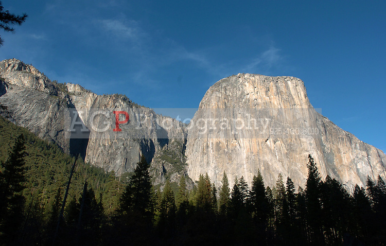 El Capitan rises above the valley floor in Yosemite National Park in California November 22, 2008. El Capitan is a favorite for experienced rock climbers. Rising more than 3,000 feet above the Valley floor, it is the largest monolith of granite in the world. El Capitan is opposite Bridalveil Fall and is best seen at the far west end of Yosemite Valley at Bridalveil and El Capitan Meadows. (Photo Copyright Alan Greth)
