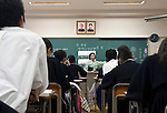 """Portraits of Kim Il-Sung, the man revered as North Korea's  """"Great Leader"""", and his son, """"Dear Leader"""" Kim Jong-Il, hang over the blackboard during a Korean Language class at the Tokyo Korean High School in Tokyo, Japan on Thursday 07 October, 2010..Photographer: Robert Gilhooly"""