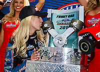 Sep 4, 2016; Clermont, IN, USA; NHRA funny car driver Courtney Force kisses the trophy as she celebrates after winning the Traxxas Shootout speciality race during qualifying for the US Nationals at Lucas Oil Raceway. Mandatory Credit: Mark J. Rebilas-USA TODAY Sports