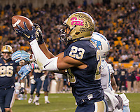 Pitt wide receiver Tyler Boyd (23) makes a catch despite the efforts of North Carolina defensive back MJ Stewart (6). The North Carolina Tar Heels football team defeated the Pitt Panthers 26-19 on Thursday, October 29, 2015 at Heinz Field, Pittsburgh, Pennsylvania.