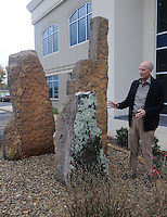 NWA Democrat-Gazette/FLIP PUTTHOFF <br /> Bailey shows    Nov. 11, 2015 a stone sculpture outside the law firm office.