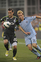 Zach Scott (20) defender Seattle Sounders holds off Seth Sinovic (16) defender Sporting KC..Sporting Kansas City defeated Seattle Sounders on penalty kicks, after a 1-1 tied game to win the Lamar Hunt Open Cup at LIVESTRONG Sporting Park, Kansas City, Kansas..