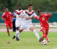 Sadi Jalali (9) of Canada moves in on Darwin Pinzon (10) of Panama during the semifinals of the CONCACAF Men's Under 17 Championship at Catherine Hall Stadium in Montego Bay, Jamaica. Canada defeated Panama, 1-0.