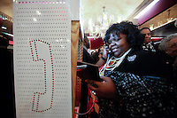 A woman calls to the WNYC line to participate on a contest during a event to commemorate Martin Luther King's day at the Apollo Theater in New York. 17.01.2016. Kena Betancur/VIEWpress.