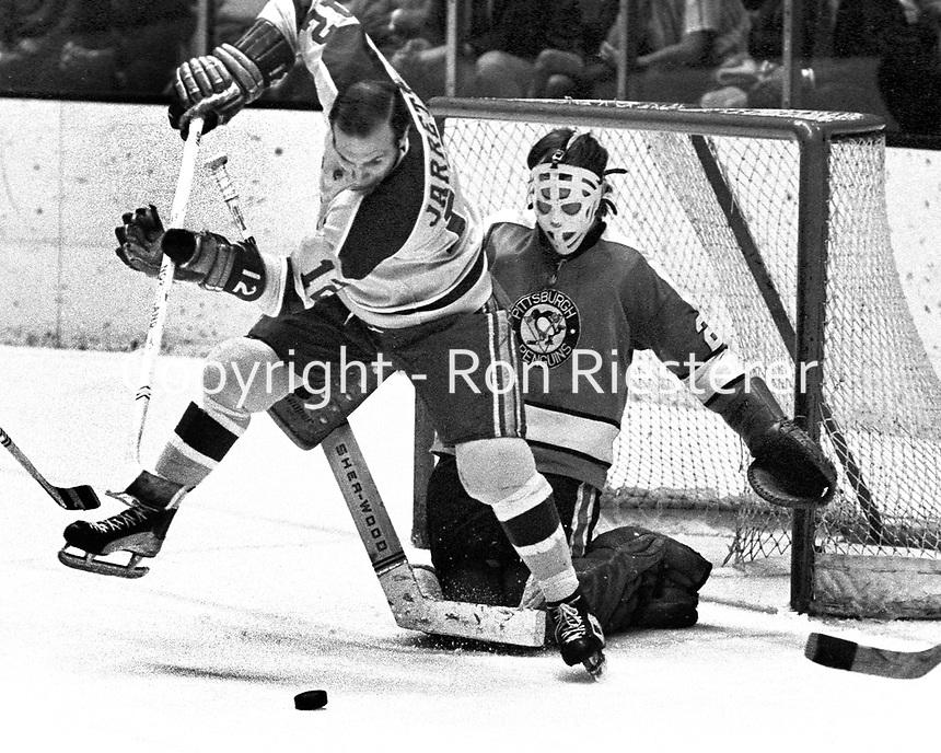 Seals Gary Jarrett in front of Penguin goalie Al Smith..(1971 photo/Ron Riesterer)