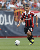 AC Milan forward Antonio Cassano (99) brings the ball forward. In an international friendly, AC Milan defeated C.D. Olimpia, 3-1, at Gillette Stadium on August 4, 2012.