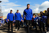 Rhys Priestland and the rest of the Bath Rugby team make their way through a tunnel of supporters. Aviva Premiership match, between Bath Rugby and London Irish on March 5, 2016 at the Recreation Ground in Bath, England. Photo by: Patrick Khachfe / Onside Images