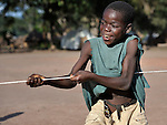 A boy plays tug of war in the Makpandu refugee camp in Southern Sudan, 44 km north of Yambio, where more that 4,000 people took refuge in late 2008 when the Lord's Resistance Army attacked their communities inside the Democratic Republic of the Congo. Attacks by the LRA inside Southern Sudan and in the neighboring DRC and Central African Republic have displaced tens of thousands of people, and many worry the attacks will increase as the government in Khartoum uses the LRA to destabilize Southern Sudan, where people are scheduled to vote on independence in January 2011. Catholic pastoral workers have accompanied the people of this camp from the beginning. NOTE: In July 2011 Southern Sudan became the independent country of South Sudan.