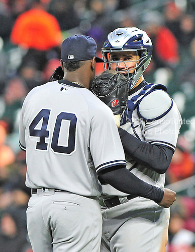 New York Yankees catcher Gary Sanchez (24), right, speaks with New York Yankees starting pitcher Luis Severino (40) to settle him down in the first inning against the Baltimore Orioles at Oriole Park at Camden Yards in Baltimore, MD on Friday, April 7, 2017.<br /> Credit: Ron Sachs / CNP<br /> (RESTRICTION: NO New York or New Jersey Newspapers or newspapers within a 75 mile radius of New York City)