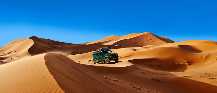 4 x4 Landrover Defnder on the Sahara sand dunes of erg Chebbi, Morocco, Africa