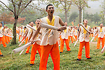 Students of Shaolin martial arts school conditioning their body with metal bars at the opening ceremony of Zhengzhou International Wushu Fetival in DengFeng, Henan, China 2014