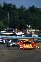WATKINS GLEN, NY - JUNE 28: The Joest Racing Porsche 962C of Gianpiero Moretti and John Paul, Jr. leads a group of cars during the Camel Continental IX IMSA GTP/Lights race at the Watkins Glen International track near Watkins Glen, New York, on June 28, 1992.