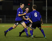 The number 24 ranked Furman Paladins took on the number 20 ranked Clemson Tigers in an inter-conference game at Clemson's Riggs Field.  Furman defeated Clemson 2-1.  Michael Gandier (18) is congratulated by teammates, Trevor Haberkorn (6) and Dylan Rowe (4) after scoring Furman's second goal.
