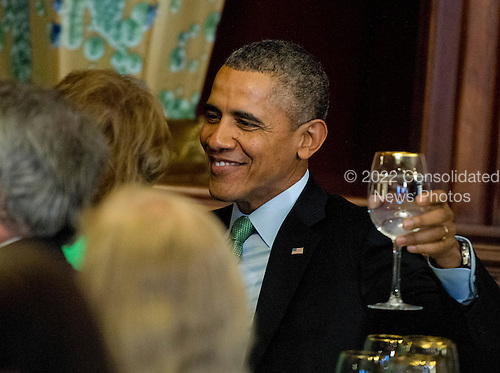 United States President Barack Obama attends a St. Patrick's Day luncheon hosted by Members of Congress and attended by Prime Minister Enda Kenny of Ireland in the U.S. Capitol in Washington, D.C. on Friday, March 14, 2014.<br /> Credit: Ron Sachs / Pool via CNP