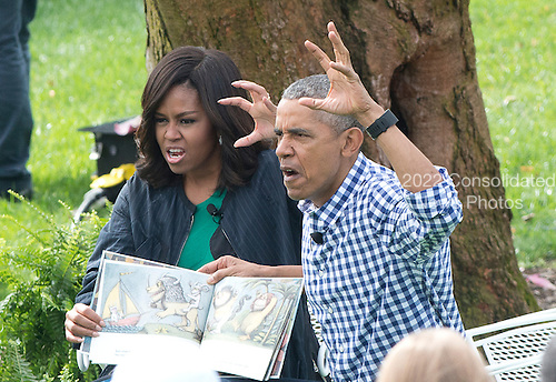 United States President Barack Obama and first lady Michelle Obama read &quot;Where the Wild things Are&quot; as they host the 2016 White House Easter Egg Roll on the South Lawn of the White House in Washington, DC on Monday, March 28, 2016.<br /> Credit: Ron Sachs / CNP
