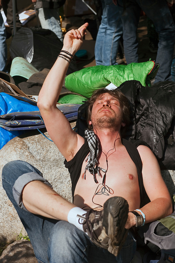 Moscow, Russia, 15/05/2012..A protester listens to music in Chistiye Prudy, or Clean Ponds, as a Moscow court ordered the eviction of some 200 opposition activists who have set up camp in the city centre park.