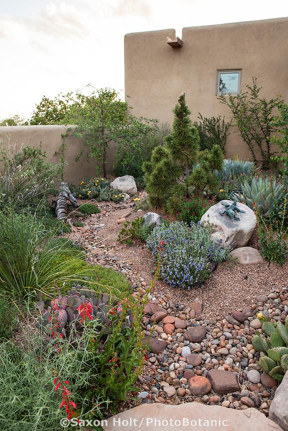 Roof gutter over dry stream water storage pumice wicks in courtyard of David Salman New Mexico garden