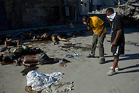 Port au Prince, Haiti, Jan 16 2010.More than 50 bodies are laying on the 'Place Sainte Anne', in front of the collapsed churche where many of them lost their lives; the risk of infections or epidemic is high as these corpses could contaminate the aquifer.