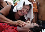 Victoria Martinez mourns over the body of her son, Carlos Martinez, a 23-year old farmworker who was shot to death on October 2 on the La Lempira Cooperative outside Tocoa, Honduras. Martinez and other members of the cooperative are among thousands of Honduran activists who have seized plantations they claim were stolen from them by wealthy Honduras businessmen. The Honduran security forces have militarized the area, and killings of peasant leaders have become common. Many of the cooperatives were started with assistance from Catholic priests and lay pastors in the region, and some Catholic leaders remain close supporters of the peasant movement. A sister of Martinez claimed he was killed by a security guard from a nearby plantation belonging to Miguel Facusse, the wealthiest of Honduran landowners.
