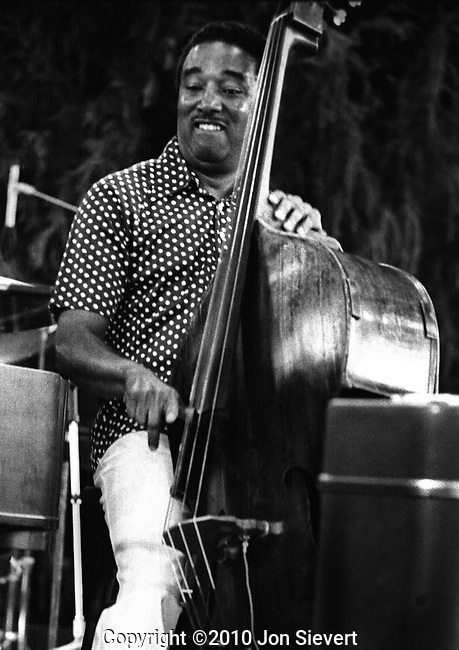 Ray Brown, July 1975, Concord Summer Festival, 16-23-28. Quintessential Jazz Bassist.  He took part in a number of early bop recording sessions with Charlie Parker, Dizzy Gillespie, Bud Powell, and others, and played in Gillespie's big band (1946-47), &quot;Two Bass Hit&quot; [mp3]. Thereafter he toured for several years as the music director for Ella Fitzgerald, who was at that time his wife.<br /> <br /> In 1951 he performed and recorded with the Milt Jackson Quartet (the forerunner of the Modern Jazz Quartet) and began a long affiliation with Oscar Peterson's trio, which brought him international recognition and a popular following; for more than a decade he dominated jazz popularity polls for the double bass. After leaving Peterson's trio in 1966 Brown settled on the West Coast, where he became active as a freelance and studio musician.