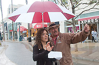 Santa Monica Ambassador J.D. Simpson shares his umbrella while escorting a tourist from Mexican along the Third Street Promenade on Tuesday, October 19, 2010. The Downtown Santa Monica Ambassador Program was created to provide an inviting and safe atmosphere in the district. Ambassadors are trained in a variety of tasks, including: providing information to visitors, giving directions, offering escort services to employees, reporting maintenance issues and any other action that serves to make the district more inviting..