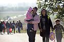 Migrants stream over the Serbian/Croatian border.