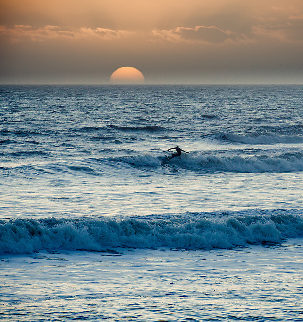 Surfing as the sun goes down at Freshwater Bay on the Isle of Wight