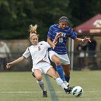 Boston College midfielder Lauren Bernard (5) tackles Duke University forward Kim DeCesare (19).Boston College (white) defeated Duke University (blue/white), 4-1, at Newton Campus Field, on October 6, 2013.