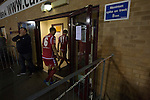 Connah's Quay Nomads 1 Llandudno 1, 20/09/2016. Deeside Stadium, Welsh Premier League. Home players walking back to the dressing rooms at half-time at the Deeside Stadium as Connah's Quay Nomads (in red) played Llandudno in a Welsh Premier League match. Both clubs represented Wales in the 2016-17 Europa League, the first time either had competed in European competition. The match ended in a 1-1 draw, watched by 181 spectators. Photo by Colin McPherson.