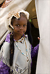 "Portriat of smiling Native and African American boy with pow wow animal head grear standing in tepee opening. ....A pow-wow (also powwow or pow wow or pau wau) is a gathering of North America's Native people. The word derives from the Narragansett word powwaw, meaning ""spiritual leader""."
