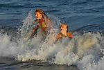 Girls body surfing in Santa Cruz