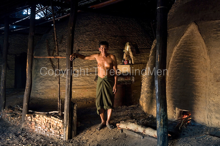 Prathin Suphaphon runs the charcoal kilns that burn mangrove wood. This has been his job for over twenty years.
