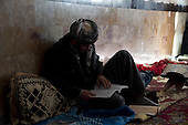 BIARA, IRAQ: Ismael (19) from Erbil studies for an exam.. .The Biara Madrassa--a religious school--is located high up in the mountainous Kurdish Hawraman region that makes up the Iran/Iraq border. Before 2003 the region was home to a fundamentalist Islamic group called Ansar al-Islam who used the school as a base. The Unites States military attacked the area and the madrassa numerous times during the 2003 invasion, finally pushing Ansar al-Islam out...Today the madrassa is home to 48 male students from all across Kurdish Iraq. The students leave their families and immerse themselves in their studies and the daily life of Koranic students...Photo by Besaran Tofiq
