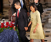 Washington, DC - January 20, 2009 -- United States President Barack Obama and first lady Michelle Obama hold hands at the end of their luncheon at Statuary Hall in the Capitol in Washington, Tuesday, January 20, 2009. .Credit: Lawrence Jackson - Pool via CNP