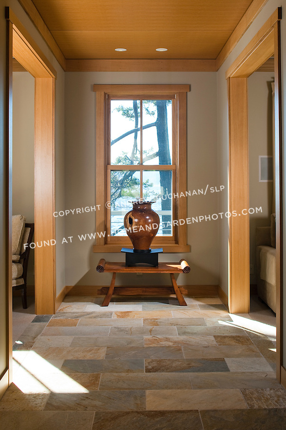 Sunlight streams into the tiled entry hall of a Pacific Northwest home. this image is available through an alternate architectural stock image agency, Collinstock located here: http://www.collinstock.com