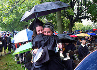 Casa Wilson, left, receives a hug from Grant Sutton during the rain soaked graduation ceremony for the University of Virginia Sunday May 18, 2003 in Charlottesville, VA.  (Photo/Andrew Shurtleff)